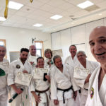 Dojo students pose for selfie after successful testing